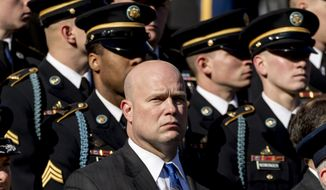 Acting United States Attorney General Matt Whitaker, center, attends a wreath laying ceremony at the Tomb of the Unknown Soldier during a ceremony at Arlington National Cemetery on Veterans Day, Sunday, Nov. 11, 2018, in Arlington, Va. (AP Photo/Andrew Harnik)