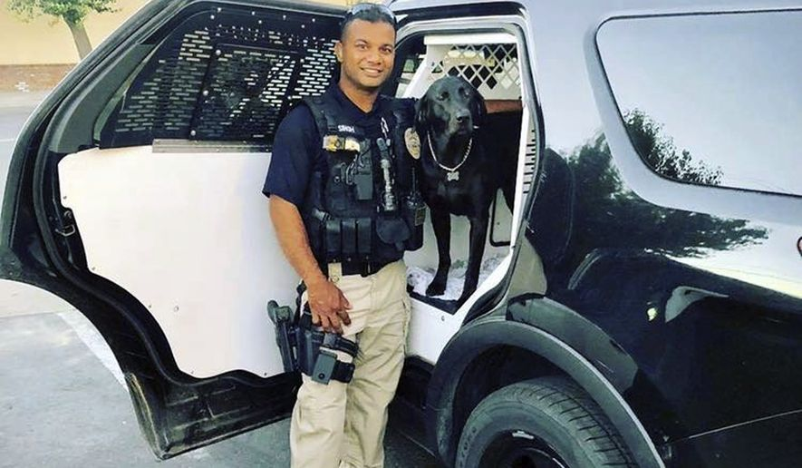 "This undated photo provided by the Newman Police Department shows officer Ronil Singh of Newman Police Department who was killed by an unidentified suspect. The Stanislaus County Sheriff's Department said Singh was conducting a traffic stop early Wednesday, Dec. 26, 2018, in the town of Newman, Calif. when he called out ""shots fired"" over his radio. (Stanislaus County Sheriff's Department via AP)"