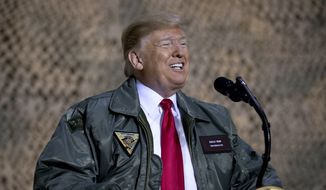 "President Donald Trump speaks at a hangar rally at Al Asad Air Base, Iraq, Wednesday, Dec. 26, 2018. President Donald Trump, who is visiting Iraq, says he has ""no plans at all"" to remove US troops from the country. (AP Photo/Andrew Harnik) **FILE**"