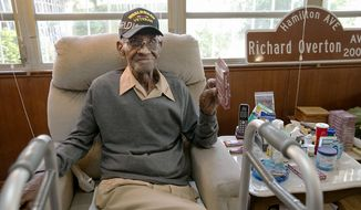 In this May 10, 2018 photo Richard Overton, the oldest living U.S. Veteran at the age of 111, is back in the east Austin home he has owned since 1948 after a renovation provided by Meals on Wheels of Central Texas and the Home Depot Foundation. A family member says Overton, the nations oldest World War II veteran who was also believed to be oldest living man in the U.S., has died in Texas. He was 112. Shirley Overton, whose husband was Richards cousin, says the Army veteran died Thursday, Dec. 27, 2018 at a rehab facility in Austin, Texas. (Ralph Barrera/Austin American-Statesman via AP, file)