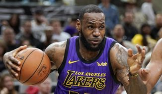 FILE - In this Dec. 7, 2018, file photo, Los Angeles Lakers' LeBron James (23) drives against the San Antonio Spurs during the first half of an NBA basketball game, in San Antonio. LeBron James was named The Associated Press Male Athlete of the Year on Thursday, Dec. 27, 2018. (AP Photo/Darren Abate, File) **FILE**