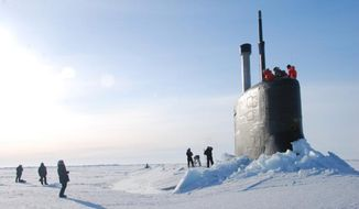 This 2016 photo provided by the U.S. Navy, shows a submarine after breaking through ice in the Beaufort Sea off Alaska's north coast. The U.S. Navy has kicked off biennial submarine testing and training under sea ice off Alaska's north coast--the exercises are dubbed Ice Exercise 2018, or ICEX18, and will include maneuvers by three submarines under Arctic ice, including a British vessel, over five weeks. (U.S. Navy via AP)