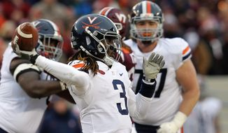 File-This Nov. 23, 2018, file photo shows Virginia quarterback Bryce Perkins (3) tossing a pass during the first half of an NCAA college football game against Virginia Tech in Blacksburg, Va. Perkins wasn't with Virginia when the Cavaliers made their first bowl appearance in six years last season, but he's heard enough about it to be in tune with what to push them to do differently this time around.  (AP Photo/Steve Helber, File) **FILE**