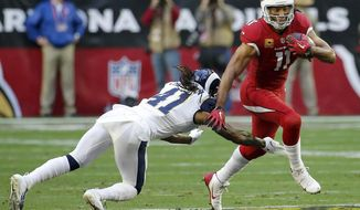 File-This Dec. 23, 2018, file photo shows Arizona Cardinals wide receiver Larry Fitzgerald (11) running as Los Angeles Rams defensive back Marqui Christian (41) defends during the first half of an NFL football game in Glendale, Ariz. An Arizona loss will clinch the top-pick in the 2019 NFL draft for the Cardinals (3-12) and may spell an end to Steve Wilks tenure as their head coach. It's been an underwhelming season for the Cardinals and the struggles have led to plenty of rumors that Wilks will only last one season. There's also the question of whether Sunday, Dec. 30, 2018, will be Fitzgerald's finale after 15 standout seasons.(AP Photo/Rick Scuteri, File)