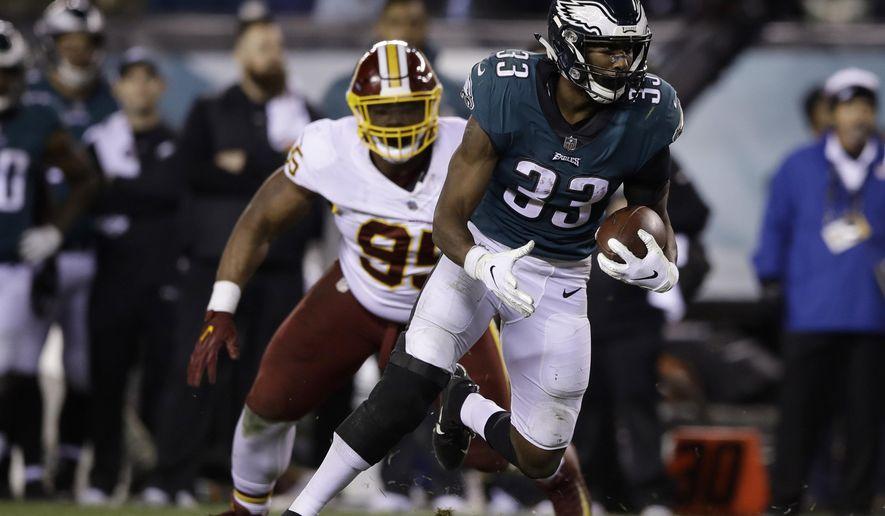 In this Dec. 3, 2018, photo, Philadelphia Eagles' Josh Adams (33) carries against the Washington Redskins during an NFL football game in Philadelphia. (AP Photo/Matt Rourke) **FILE**