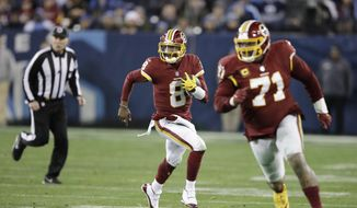 In this Dec. 22, 2018, file photo, Washington Redskins quarterback Josh Johnson (8) scrambles behind offensive tackle Trent Williams (71) during the second half of the team's NFL football game against the Tennessee Titans in Nashville, Tenn. Scrambling quarterbacks have given the Philadelphia Eagles trouble this season. Deshaun Watson had 49 yards rushing last week. Washington's Johnson has run for 116 yards on 20 carries. (AP Photo/James Kenney) ** FILE **