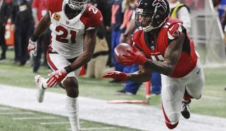 File-This Dec. 16, 2018, file photo shows Atlanta Falcons wide receiver Julio Jones, right, catching a touchdown pass past Arizona Cardinals cornerback Patrick Peterson during the first half of a NFL football game in Atlanta. Every year Julio Jones puts up big numbers while the Atlanta Falcons fall short of a championship. And every year he puts a positive spin on what went wrong and what looks promising heading into next season. The two-time All-Pro and six-time Pro Bowl receiver has towed the company line since he arrived from Alabama as the NFL's sixth overall draft pick in 2011. (Curtis Compton/Atlanta Journal-Constitution via AP, File)