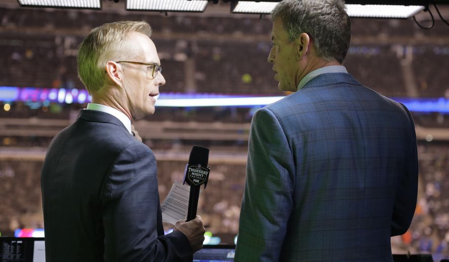 """FILE - This Oct. 11, 2018, file photo shows Troy Aikman, right, and Joe Buck working before an NFL football game between the New York Giants and the Philadelphia Eagles  in East Rutherford, N.J. """"I remember opening weekend when I got home I had a couple college buddies that were raving about the pregame show and how great and fun it was with everyone,"""" said Aikman, who was Cowboys quarterback in 1994 before joining the network seven years later. """"It was refreshing, new and unique, and that set the tone for the network.""""(AP Photo/Frank Franklin II, File)"""