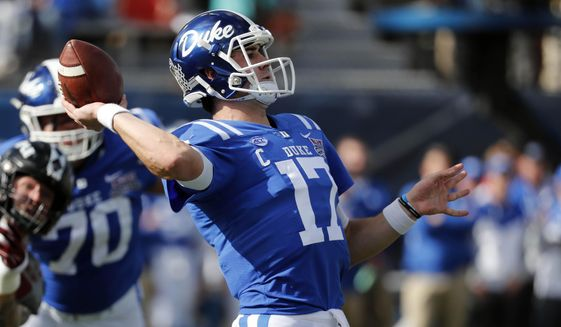 Duke quarterback Daniel Jones (17) sets to pass against Temple during the first half of the Independence Bowl, an NCAA college football game in Shreveport, La., Thursday, Dec. 27, 2018. (AP Photo/Rogelio V. Solis) **FILE**