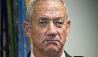 File - In this Thursday, Jan. 8, 2015 file photo, Israeli Defense Minister Benny Gantz pauses as he answers questions from members of the media during his meeting with Joint Chiefs Chairman Gen. Martin E. Dempsey, at the Pentagon. Gantz, former Israeli military chief, says he is running in the upcoming election. (AP Photo/Pablo Martinez Monsivais, File)