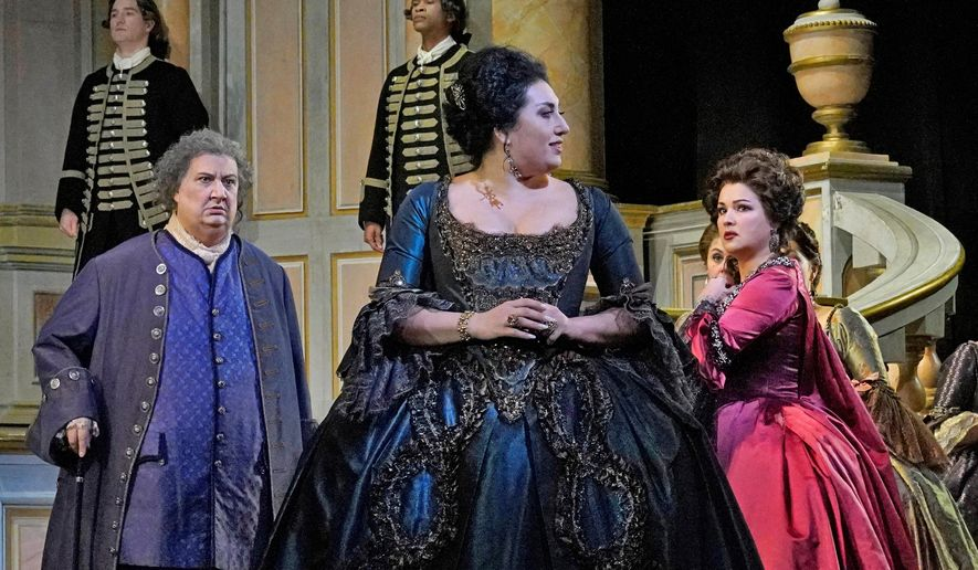 """In this 2018 photo, Ambrogio Maestri, from left, as Michonnet, Anita Rachvelishvili as the Princess of Bouillon, and Anna Netrebko as Adriana Lecouvreur perform during a rehearsal of the Metropolitan Opera's new production of """"Adriana Lecouvreur,"""" which opens New Year's Eve, Dec. 31, 2018, at the Metropolitan Opera in New York. (Ken Howard/Metropolitan Opera via AP)"""