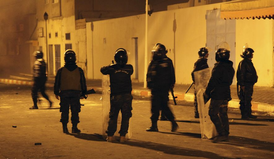 Tunisian Police officers patrol after clashes in the streets of Kasserine, southern of Tunisia, Wednesday, Dec 26, 2018.The death of a Tunisian journalist Abderrak Zorgui who set himself on fire to protest economic problems in the North African nation prompted a protest that led to clashes with police and nationwide concern. (AP Photo/Walid Ben Sassi)