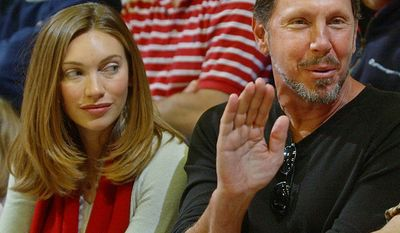 Novelist Melanie Craft and Larry Ellison,  businessman, entrepreneur, and co-founder, executive chairman and chief technology officer of Oracle Corporation.                                         Oracle CEO and Stanford fan Larry Ellison, 59, waves as he sit next to his new wife, Melanie Craft, 34, during the Stanford basketball game against Arizona, Saturday, Feb. 7, 2004, in Stanford, Calif.  Stanford defeated Arizona, 80-77. Ellison and Craft were married Dec. 18, 2003.  (AP Photo/Paul Sakuma)