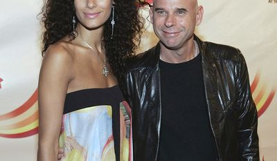 """Claudia Barilla and Guy Laliberte, businessman, investor, poker player, and musician. He is the co-founder of Cirque du Soleil.                                     Cirque du Soleil creator Guy Laliberte and his companion Claudia Barilla arrive at the premier of The Beatles """"LOVE"""" Cirque du Soleil's surrealistic portrayal of the Fab Four's career at the Mirage Hotel and Casino in Las Vegas on Friday, June 30, 2006. (AP Photo/Laura Rauch)"""