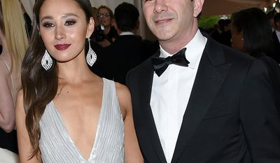 """Gabi Holzwarth and Travis Kalanick, Travis Kalanick, businessman, co-founder of Scour, Red Swoosh and Uber.                                                Gabi Holzwarth, left, and Travis Kalanick arrive at The Metropolitan Museum of Art Costume Institute Benefit Gala, celebrating the opening of """"Manus x Machina: Fashion in an Age of Technology"""" on Monday, May 2, 2016, in New York. (Photo by Evan Agostini/Invision/AP)"""