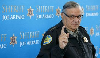 FILE - In this Dec. 18, 2013, file photo, Maricopa County Sheriff Joe Arpaio pauses as he answers a question during a news conference at Maricopa County Sheriff's Office Headquarters in Phoenix. Maricopa County has asked the U.S. Supreme Court to review a lower-court ruling that concluded it's liable in lawsuits over former Sheriff Arpaio's crackdowns on immigrants during traffic stops. The appeal filed on Dec. 6 isn't aimed at recouping the millions of dollars that taxpayers have shelled out in lawsuits that challenged the patrols. The appeal was made in a lawsuit in which Arpaio's officers were found to have profiled Latinos in immigration patrols. (AP Photo/Ross D. Franklin, File)