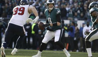 FILE - In this Dec. 23, 2018, file photo, Philadelphia Eagles quarterback Nick Foles looks for a receiver as Houston Texans's J.J. Watt rushes during the first half an NFL football game in Philadelphia. The Eagles would earn the NFC's final wild-card berth if they win Sunday and the Vikings (8-6-1) lose at home against the Bears (11-4). Foles has performed well in high-pressure situations the past two seasons while filling in for Carson Wentz. He's 5-0 in must-win games and earned Super Bowl MVP honors in a win over New England last February. (AP Photo/Matt Rourke, File)