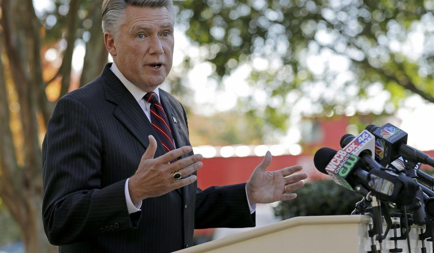 FILE - In this Nov. 7, 2018 file photo Republican Mark Harris speaks to the media during a news conference in Matthews, N.C. The North Carolina board investigating allegations of ballot fraud in a still-unresolved congressional race between Harris and Democrat Dan McCready could be disbanded Friday, Dec. 28 under a state court ruling in a protracted legal battle about how the panel operates. The state Elections Board has refused to certify the race between Harris and McCready while it investigates absentee ballot irregularities in the congressional district stretching from the Charlotte area through several counties to the east. Harris holds a slim lead in unofficial results, but election officials are looking into criminal allegations against an operative hired by the Harris campaign.  (AP Photo/Chuck Burton, File)