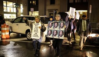 Protestors walk on Broad Street to demonstrate for Mumia Abu-Jamal outside the offices of District Attorney Larry Krasner, Friday, Dec. 28, 2018, in Philadelphia. A judge issued a split ruling Thursday that grants Abu-Jamal another chance to appeal his 1981 conviction in a Philadelphia police officer's death. (AP Photo/Matt Slocum)