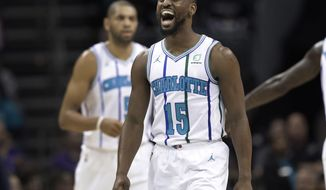 Charlotte Hornets' Kemba Walker (15) celebrates after making a basket against the Brooklyn Nets during the first half of an NBA basketball game in Charlotte, N.C., Friday, Dec. 28, 2018. (AP Photo/Chuck Burton)
