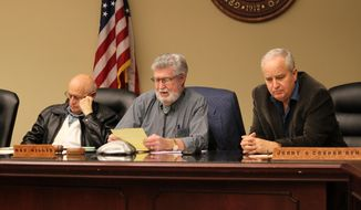 New Mexico Racing Commission Chairman Ray Willis, center, addresses those gathered for a special meeting in Albuquerque, N.M., on Friday, Dec. 28, 2018. The commission following a closed-door session decided for a third time to put off a vote on issuing the state's sixth and final license for a new racetrack and casino operation. (AP Photo/Susan Montoya Bryan)