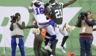File- This Nov. 11, 2018, file photo shows Buffalo Bills wide receiver Robert Foster (16) making a catch against New York Jets cornerback Morris Claiborne (21) during the fourth quarter of an NFL football game, in East Rutherford, N.J. Foster couldn't help but remember being in the same shoes,  literally and physically. So when a 14-year-old boy was trying on an expensive pair of Adidas Yeezy's, and uncertain if his mother could afford them, the Buffalo Bills rookie receiver stepped in.(AP Photo/Bill Kostroun, File)