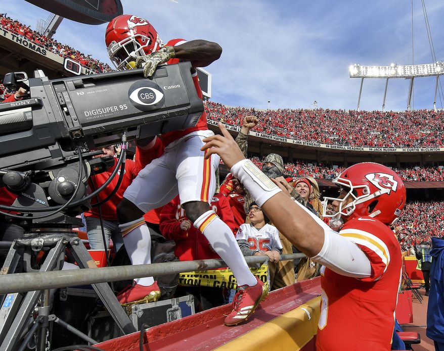 File-This Nov. 11, 2018, file photo shows Kansas City Chiefs quarterback Patrick Mahomes, right, cheering on wide receiver Tyreek Hill as he takes over the end zone camera after scoring a touchdown on a pass from Mahomes in the second quarter of an NFL football game in Kansas City, Mo. Just allowing more intricate and creative celebrations was a positive. And positively the best of a strong group, individually, was Hill catching a TD pass against Arizona in Week 10, then jumping into the stands to operate the CBS TV camera. (John Sleezer/The Kansas City Star via AP, File)