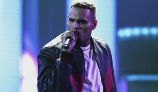 """FILE - In this June 25, 2017, file photo, Chris Brown performs at the BET Awards at the Microsoft Theater in Los Angeles. Brown released a 45-song album """"Heartbreak on a Full Moon"""" on Tuesday, Oct. 31. Brown has been charged with monkey-related misdemeanors.The Los Angeles city attorney's office confirms Thursday, Dec. 27, 2018, that the 29-year-old singer was charged last week with two counts stemming from his possession of a pet capuchin monkey without a permit. (Photo by Matt Sayles/Invision/AP, File)"""