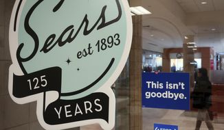 "In this Nov. 2, 2018 photo, a sign in the window at Sears promises that ""This isn't goodbye,"" at the Livingston Mall in Livingston, N.J. Sears is closing 80 more stores as it teeters on the brink of liquidation. The 130-year old retailer set a deadline of Friday, Dec. 28, 2018 for bids for its remaining stores to avert closing down completely.  (AP Photo/Ted Shaffrey)"