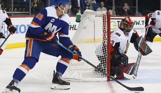 Ottawa Senators goaltender Mike McKenna (33) defends against New York Islanders center Brock Nelson (29) during the second period of an NHL hockey game, Friday, Dec. 28, 2018, in New York. (AP Photo/Noah K. Murray)