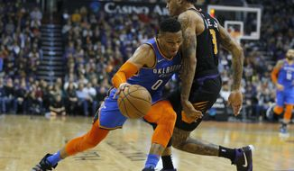Oklahoma City Thunder guard Russell Westbrook (0) gets fouled by Phoenix Suns forward Kelly Oubre Jr in the first half during an NBA basketball game, Friday, Dec. 28, 2018, in Phoenix. (AP Photo/Rick Scuteri)