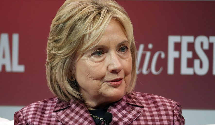 In this Tuesday, Oct. 2, 2018, file photo, former Secretary of State Hillary Clinton talks with Jeffrey Goldberg, editor in chief of The Atlantic, during The Atlantic Festival, in Washington. (AP Photo/Alex Brandon, File)