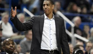 File-This Feb. 15, 2018, file photo shows Connecticut head coach Kevin Ollie during the first half an NCAA college basketball game, in Hartford, Conn. The University of Connecticut is asking a federal judge to dismiss a complaint filed by former coach Ollie, who claims his firing was in part racially motivated. (AP Photo/Jessica Hill, File)