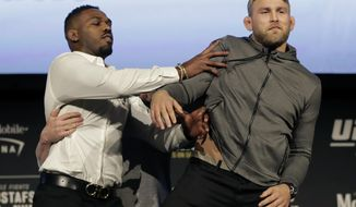 FILE - In this Nov. 2, 2018, file photo, Jon Jones, left, pushes Alexander Gustafsson out of the way during a news conference about their light heavyweight bout at Madison Square Garden in New York.  UFC 232 is on track to sell out the Forum in Inglewood just six days after the end-of-the-year show was moved from Las Vegas to Southern California. That is a testament to the quality of a card headlined by Jones' return to the UFC against Gustafsson. (AP Photo/Julio Cortez, File)