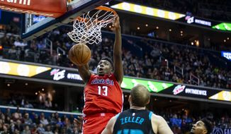 Washington Wizards center Thomas Bryant (13) dunks in front of Charlotte Hornets center Cody Zeller (40 during the second half of an NBA basketball game Saturday, Dec. 29, 2018, in Washington. Washington won 130-126. (AP Photo/Al Drago) ** FILE **