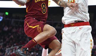 Cleveland Cavaliers guard Jordan Clarkson (8) goes up against the defense of Atlanta Hawks center Alex Len (25) during the first half of an NBA basketball game, Saturday, Dec. 29, 2018, in Atlanta. (AP Photo/John Amis)