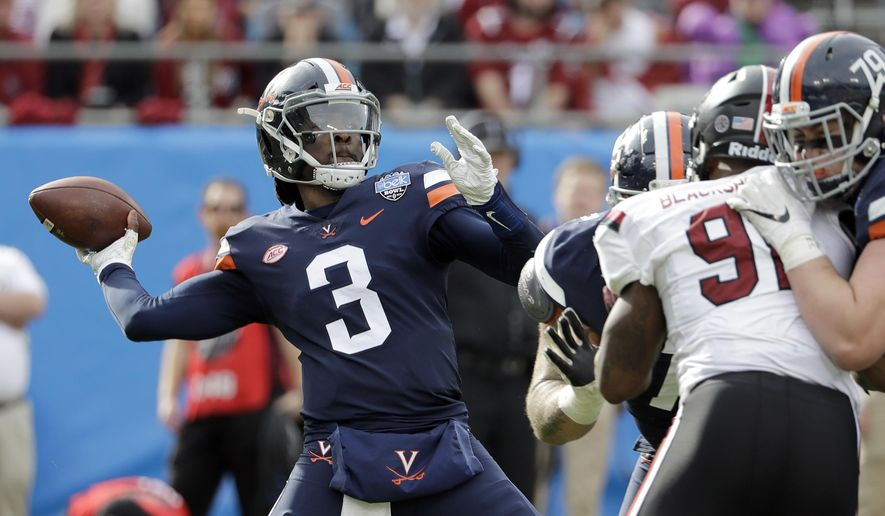 Virginia's Bryce Perkins (3) looks to pass against South Carolina during the first half of the Belk Bowl NCAA college football game in Charlotte, N.C., Saturday, Dec. 29, 2018. (AP Photo/Chuck Burton) ** FILE **