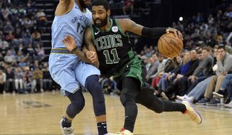 Boston Celtics guard Kyrie Irving (11) drives against Memphis Grizzlies guard Garrett Temple (17) during the second half of an NBA basketball game Saturday, Dec. 29, 2018, in Memphis, Tenn. (AP Photo/Brandon Dill)