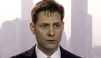 "FILE - In this file image made from a video taken on March 28, 2018, Michael Kovrig, an adviser with the International Crisis Group, a Brussels-based non-governmental organization, speaks during an interview in Hong Kong. Kovrig, a Canadian, disappeared days after Canada detained Huawei chief financial officer Meng Wanzhou. It's not uncommon for individuals who speak out against the government to disappear in China, but the scope of the ""disappeared"" has expanded since President Xi Jinping came to power in 2013. Not only dissidents and activists, but also high-level officials, Marxists, foreigners and even a movie star _ people who never publicly opposed the ruling Communist Party, have been whisked away by police to unknown destinations. (AP Photo/File)"