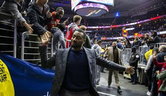 Washington Wizards guard John Wall leaves the court following the team's NBA basketball game against the Charlotte Hornets, Saturday, Dec. 29, 2018, in Washington. Washington won 130-126. (AP Photo/Al Drago)