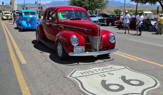 """FILE - This 2017 file photo shows the annual Route 66 Fun Run, featuring vintage autos from all eras, on a street in Kingman, Ariz. Illinois lawmakers completed the state's 100th General Assembly in its bicentennial year, and will ring in 2019 with 253 new laws on the books. Also, Route 66, the storied """"Mother Road"""" that connected Chicago to Santa Monica, Calif., in one of the nation's earliest interstate highways, turns 100 in 2026. A commission to celebrate its centennial begins work. (Kingman Daily Minor via AP)"""