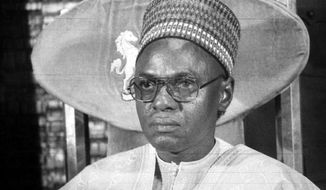 "FILE - In this B/W file photo dated circa 1983, showing President of Nigeria Shehu Shagari, at a press conference in Lagos. The 93-year old Shehu Shagari, Nigeria's second president whose civilian tenure was sandwiched between military rulers, has died and Nigeria's current President Muhammadu Buhari, said on Saturday Dec. 29, 2018, that he mourns ""the departure of a patriot."" (AP Photo)"