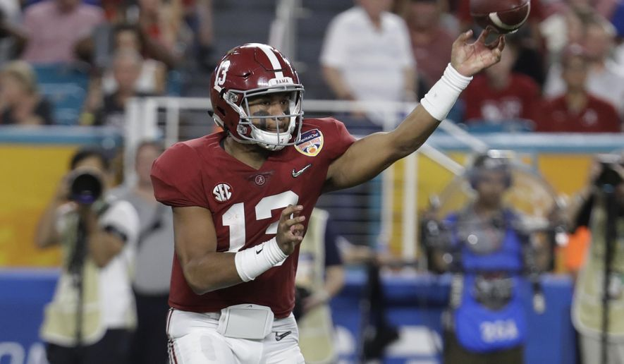 Alabama quarterback Tua Tagovailoa (13) looks to pass, during the first half of the Orange Bowl NCAA college football game against Oklahoma, Saturday, Dec. 29, 2018, in Miami Gardens, Fla. (AP Photo/Lynne Sladky)