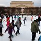 "People skate on the National Gallery of Art Sculpture Garden Ice Rink, Thursday, Dec. 27, 2018, as a partial government shutdown continues in Washington. The museum and the skate rink will be closed to the public after January 2nd as a result of the shutdown if it continues into the new year. Behind the rink is the National Archives, which is closed due to the shutdown. President Donald Trump has vowed to hold the line on his budget demand, telling reporters during his visit to Iraq Wednesday that he'll do ""whatever it takes"" to get money for border security. The White House and congressional Democrats have been talking but to little effect. (AP Photo/Jacquelyn Martin)"