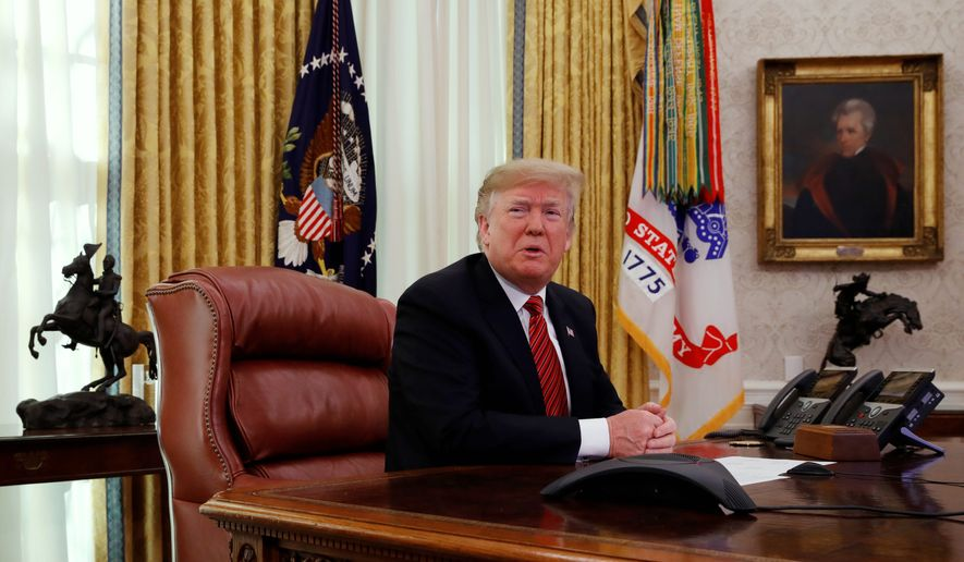 President Donald Trump answers questions from the media after speaking with members of the military by video conference on Christmas Day, Tuesday, Dec. 25, 2018, in the Oval Office of the White House. (AP Photo/Jacquelyn Martin) ** FILE **
