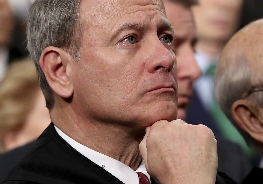 In this Tuesday, Jan. 30, 2018, file photo, U.S. Supreme Court Chief Justice John Roberts listens as President Donald Trump delivers his first State of the Union address in the House chamber of the U.S. Capitol to a joint session of Congress Tuesday in Washington. (Win McNamee/Pool via AP) ** FILE **