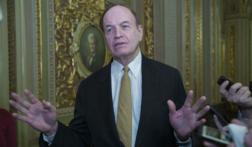 Sen. Richard Shelby, R-Ala., talks with reporters as they work to pass a bill that would pay for President Donald Trump's border wall and avert a partial government shutdown, on Capitol Hill, Friday, Dec. 21, 2018, in Washington. (AP Photo/Alex Brandon) ** FILE **