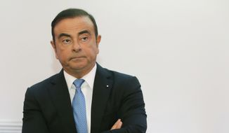 In this Oct. 6, 2017, file photo, Renault Group CEO Carlos Ghosn listens during a media conference at La Defense business district, outside Paris, France. A Japanese news report says former Nissan chairman Carlos Ghosn will be detained at least through Jan. 11, 2019. Ghosn, who led Nissan Motor Co. for two decades saving the Japanese automaker from near bankruptcy, was arrested Nov. 19, 2018, on suspicion of falsifying financial reports. (AP Photo/Michel Euler, File)