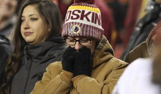A Washington Redskins fans reacts in the closing minutes of the NFL football game between the Washington Redskins and the Philadelphia Eagles, Sunday, Dec. 30, 2018 in Landover, Md. The Eagles defeated the Redskins 24-0. (AP Photo/Andrew Harnik)
