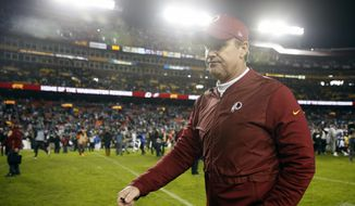 Washington Redskins head coach Jay Gruden walks off the field after anNFL football game against the Philadelphia Eagles, Sunday, Dec. 30, 2018, in Landover, Md. (AP Photo/Andrew Harnik)
